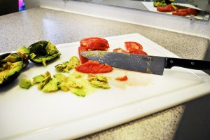 Cutting board with chopped sliced avocados and tomatoes. Photo by Megan Swiertz