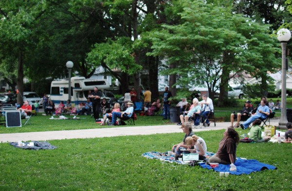 Concert goers watch the performance in Carle Park. Urbana, IL. Photo by Diana Diggs