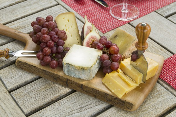 Wooden cheese board with spread. Photo by flickr user Didriks