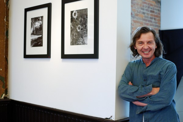 Lyosha Svinarski with some of his works in Drawing with Light at the Urbana Museum of Photography. Photo by Alyssa Abay